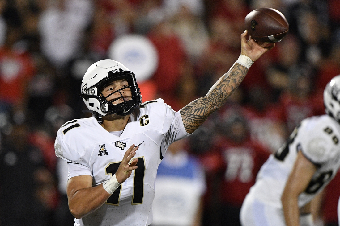 Sep 17, 2021; Louisville, Kentucky, USA;  UCF Knights quarterback Dillon Gabriel (11) throws a pass against the Louisville Cardinals during the second half at Cardinal Stadium. Louisville defeated Central Florida 42-35. Mandatory Credit: Jamie Rhodes-USA TODAY Sports