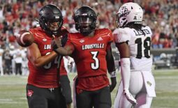Sep 17, 2021; Louisville, Kentucky, USA;  Louisville Cardinals quarterback Malik Cunningham (3) celebrates a touchdown with tight end Dez Melton (84) during the second half against the UCF Knights at Cardinal Stadium. Louisville defeated Central Florida 42-35. Mandatory Credit: Jamie Rhodes-USA TODAY Sports