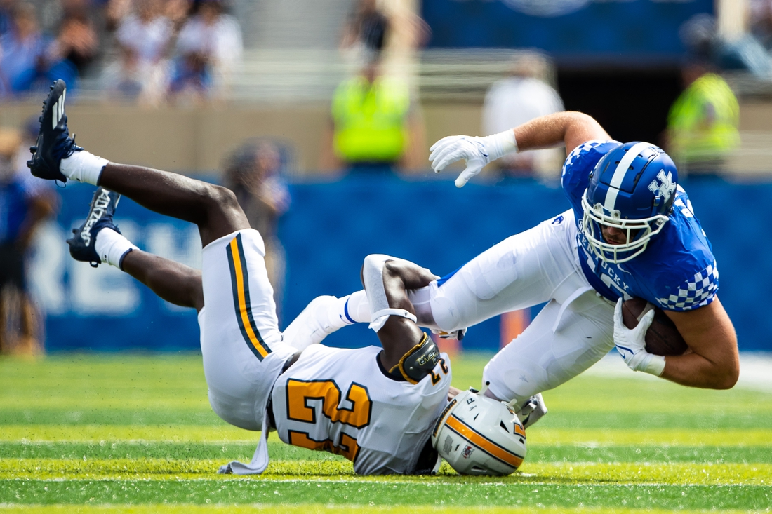 Sep 18, 2021; Lexington, Kentucky, USA; Kentucky Wildcats tight end Brenden Bates (80) is tackled by Chattanooga Mocs defensive back Jerrell Lawson (27) during the second quarter at Kroger Field. Mandatory Credit: Jordan Prather-USA TODAY Sports
