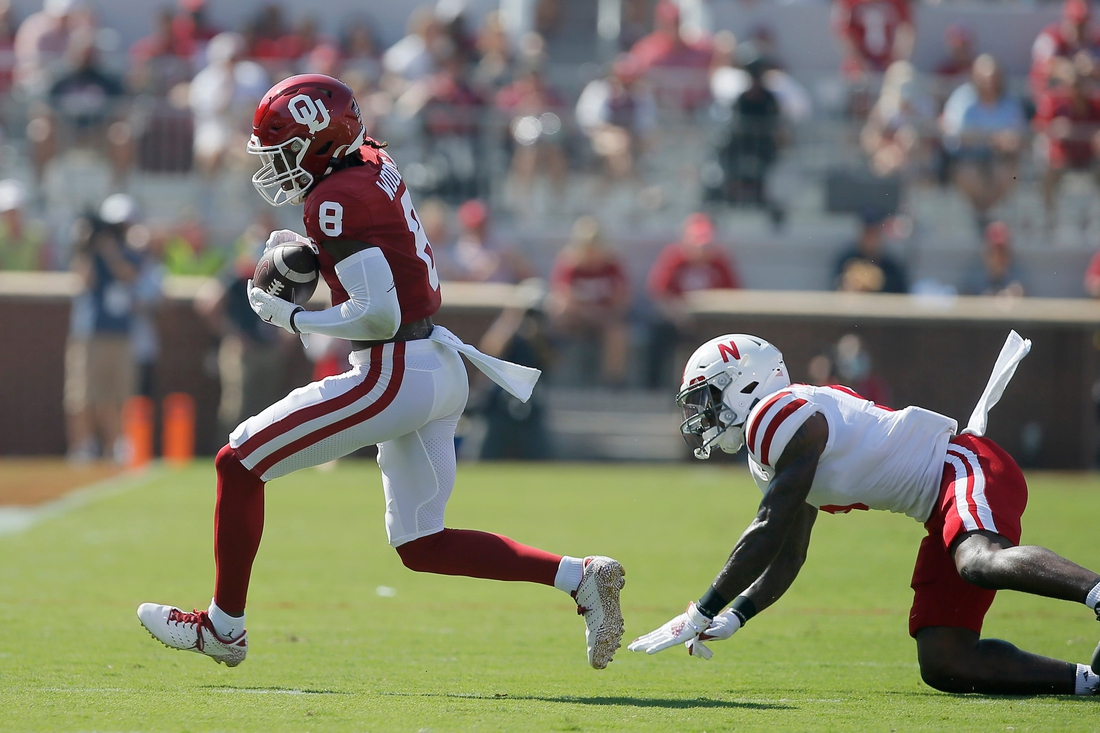 Oklahoma's Michael Woods II (8) catches the ball in front of of Nebraska's Cam Taylor-Britt (5) during a college football game between the University of Oklahoma Sooners (OU) and the Nebraska Cornhuskers at Gaylord Family-Oklahoma Memorial Stadium in Norman, Okla., Saturday, Sept. 18, 2021.  Lx14541