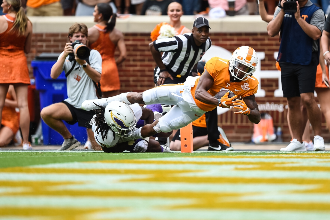 Sep 18, 2021; Knoxville, Tennessee, USA; Tennessee Volunteers wide receiver Velus Jones Jr. (1) dives over Tennessee Tech Golden Eagles defensive back Jamaal Boyd (8) for a touchdown during the first half at Neyland Stadium. Mandatory Credit: Bryan Lynn-USA TODAY Sports