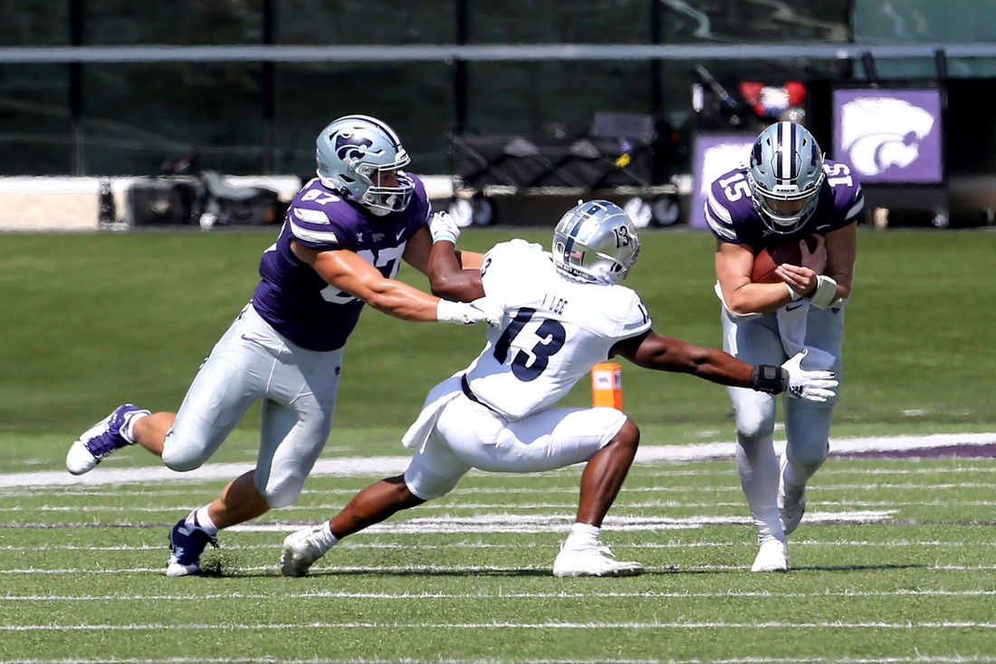 Sep 18, 2021; Manhattan, Kansas, USA; Nevada Wolf Pack defensive back Jordan Lee (13) tries to break away from the block by Kansas State Wildcats tight end Nick Lenners (87) to tackle Wildcats quarterback Will Howard (15) during the first quarter of a game at Bill Snyder Family Football Stadium. Mandatory Credit: Scott Sewell-USA TODAY Sports