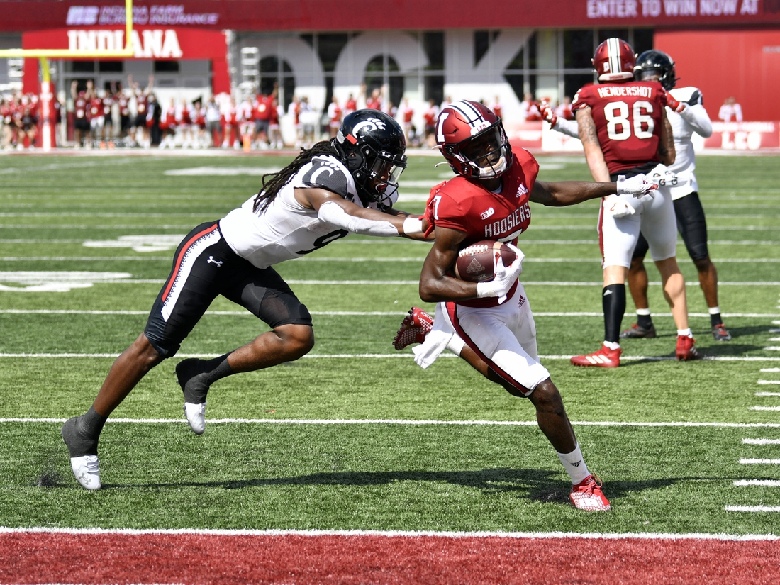 Sep 18, 2021; Bloomington, Indiana, USA; Indiana Hoosiers wide receiver D.J. Matthews Jr. (7) runs the ball into the end zone for a touchdown against Cincinnati Bearcats cornerback Arquon Bush (9) during the second half at Memorial Stadium. Bearcats won 38-24. Mandatory Credit: Marc Lebryk-USA TODAY Sports