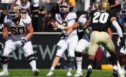 Sep 18, 2021; Boulder, Colorado, USA; Minnesota Golden Gophers quarterback Tanner Morgan (2) takes a snap in the first quarter against the Colorado Buffaloes at Folsom Field. Mandatory Credit: Ron Chenoy-USA TODAY Sports