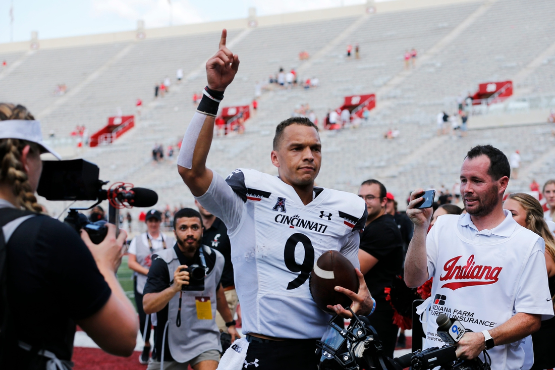 Cincinnati Bearcats quarterback Desmond Ridder (9) runs for the locker room after the Bearcats win in the fourth quarter of the NCAA football game between the Indiana Hoosiers and the Cincinnati Bearcats at Memorial Stadium in Bloomington, Ind., on Saturday, Sept. 18, 2021. The Bearcats won 38-24.  Cincinnati Bearcats At Indiana Hoosiers Football