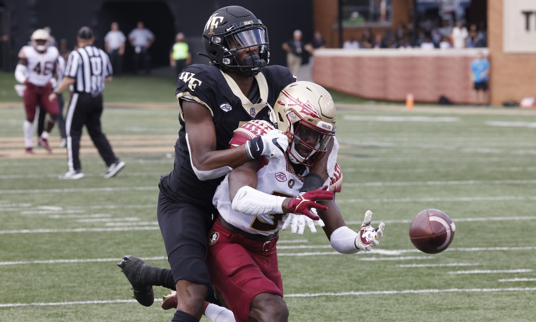 Sep 18, 2021; Winston-Salem, North Carolina, USA; Florida State Seminoles defensive back Jarvis Brownlee Jr. (3) is flagged for interference on Wake Forest Demon Deacons wide receiver Jaquarii Roberson (5) during the second quarter at Truist Field. Mandatory Credit: Reinhold Matay-USA TODAY Sports