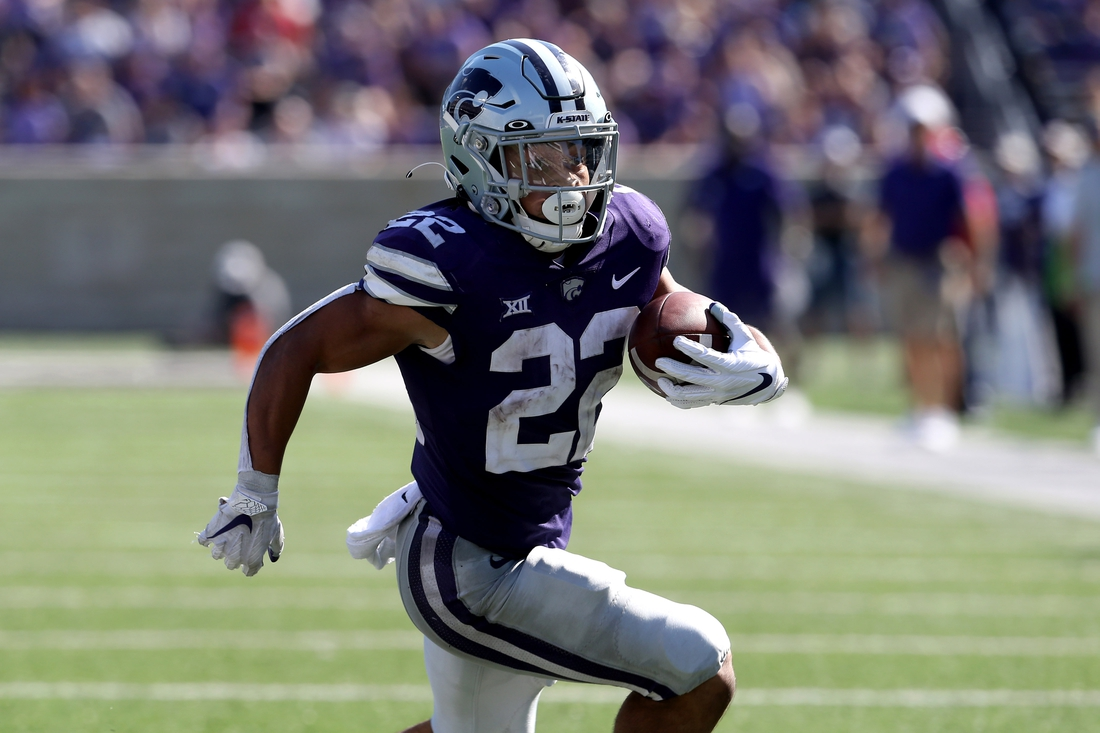 Sep 18, 2021; Manhattan, Kansas, USA; Kansas State Wildcats running back Deuce Vaughn (22) carries the ball during the fourth quarter against the Nevada Wolf Pack at Bill Snyder Family Football Stadium. Mandatory Credit: Scott Sewell-USA TODAY Sports
