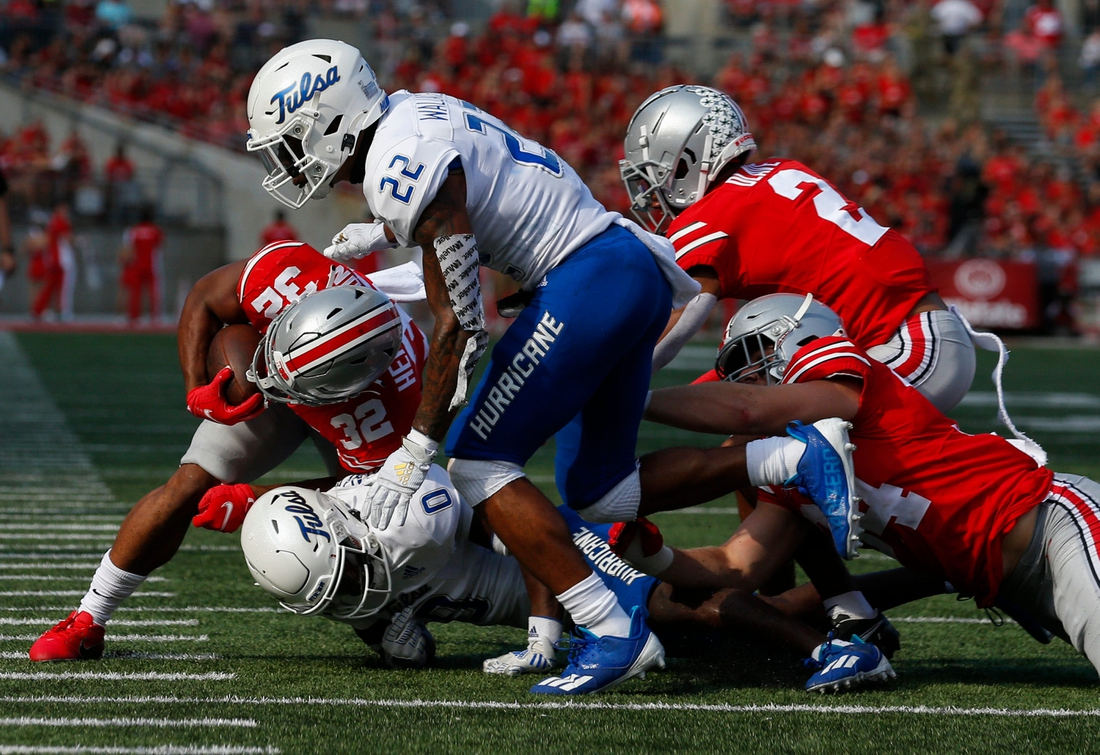 Ohio State Buckeyes running back TreVeyon Henderson (32) runs the ball during the second quarter of a NCAA Division I football game between the Ohio State Buckeyes and the Tulsa Golden Hurricane on Saturday, Sept. 18, 2021 at Ohio Stadium in Columbus, Ohio.  Cfb Tulsa Golden Hurricane At Ohio State Buckeyes
