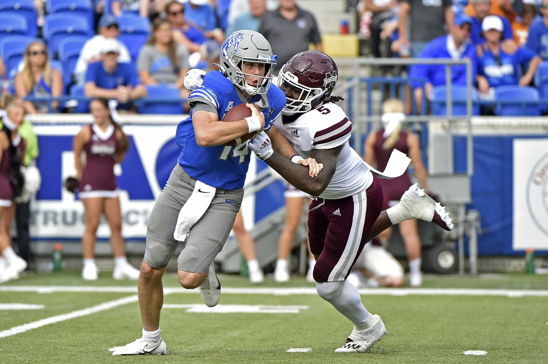 Sep 18, 2021; Memphis, Tennessee, USA; Memphis Tigers quarterback Seth Henigan (14) is pressured by Mississippi State Bulldogs defensive end Randy Charlton (5) during the first half at Liberty Bowl Memorial Stadium. Mandatory Credit: Justin Ford-USA TODAY Sports