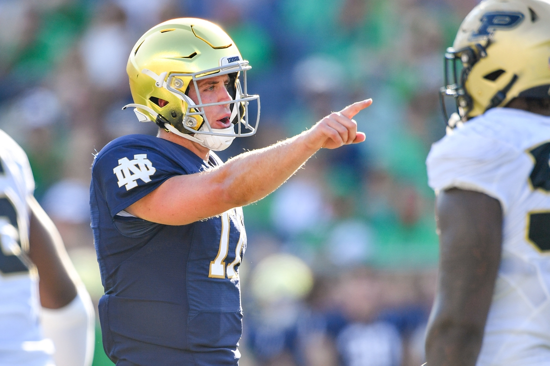 Sep 18, 2021; South Bend, Indiana, USA; Notre Dame Fighting Irish quarterback Jack Coan (17) signals in the fourth quarter against the Purdue Boilermakers at Notre Dame Stadium. Mandatory Credit: Matt Cashore-USA TODAY Sports