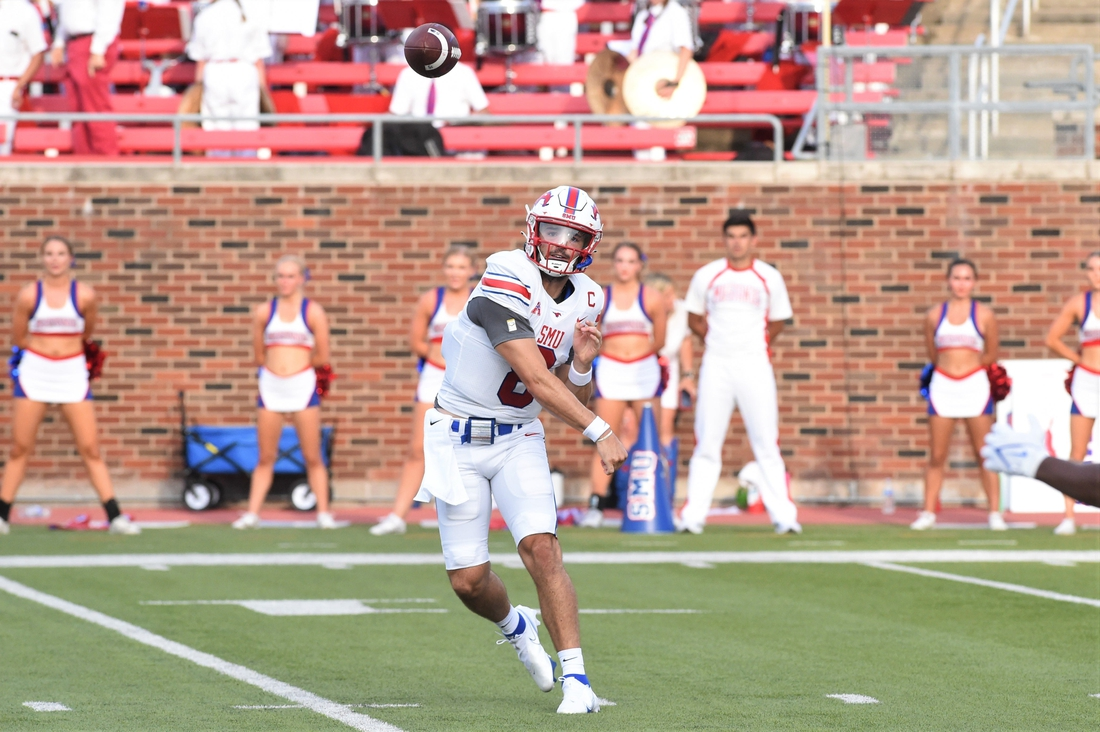 SMU quarterback Tanner Mordecai (8) lets go of a pass during Saturday's game against ACU at Gerald J. Ford Stadium in Dallas on Sept. 4, 2021. Mordecai threw an SMU-record seven touchdowns as the Mustangs won 56-9.  Hof 7364 2