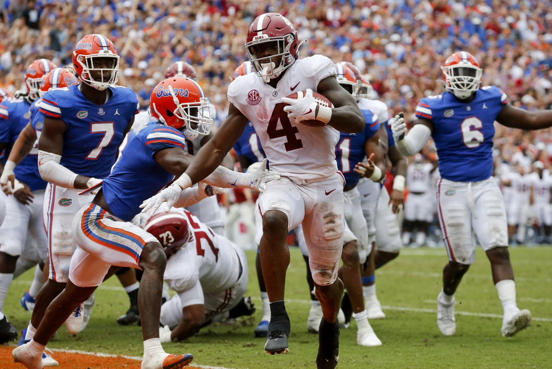 Sep 18, 2021; Gainesville, Florida, USA;  Alabama running back Brian Robinson Jr. (4) runs around Florida defenders for a touchdown at Ben Hill Griffin Stadium. Alabama defeated Florida 31-29. Mandatory Credit: Gary Cosby-USA TODAY Sports