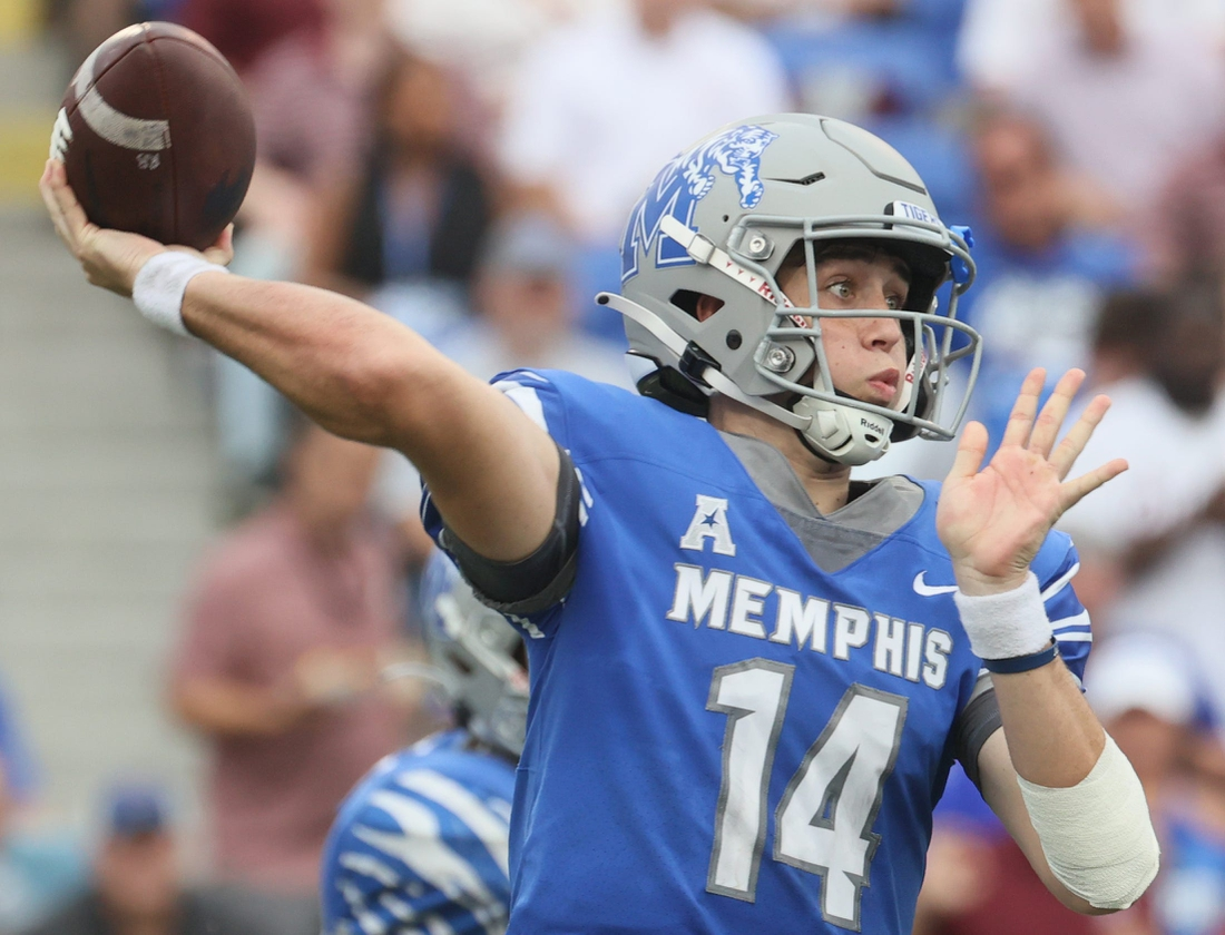Memphis Tigers quarterback Seth Henigan throws the ball against the Mississippi State Bulldogs at Liberty Bowl Memorial Stadium on Saturday, Sept. 18, 2021.  Jrca5793