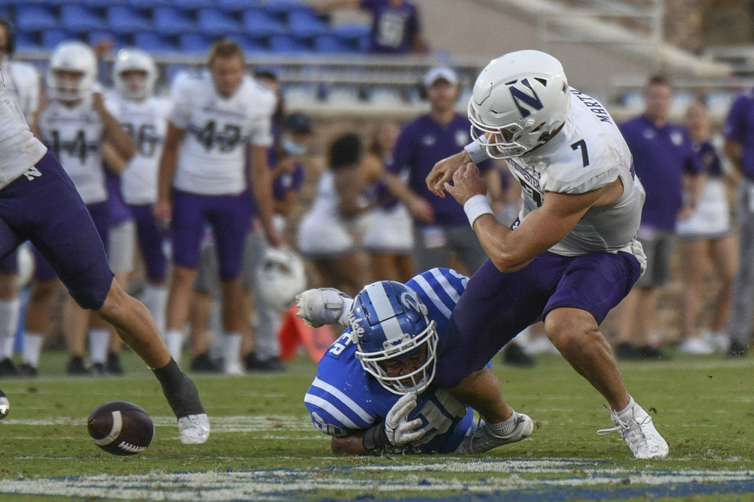 Sep 18, 2021; Durham, North Carolina, USA; Northwestern Wildcats quarterback Andrew Marty (7) fumbles the ball on a keeper during the fourth quarter at Wallace Wade Stadium. Mandatory Credit: William Howard-USA TODAY Sports