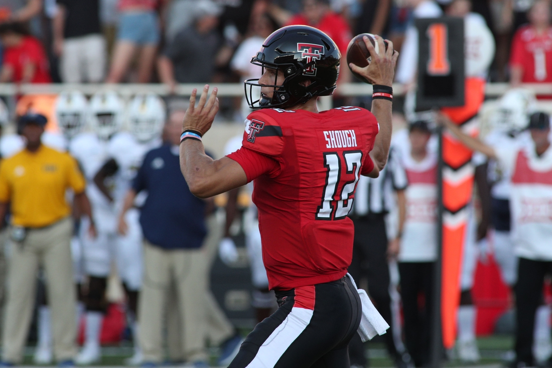 Sep 18, 2021; Lubbock, Texas, USA; Texas Tech Red Raiders quarterback Tyler Shough (12) throws a pass against the Florida International Panthers in the first half at Jones AT&T Stadium. Mandatory Credit: Michael C. Johnson-USA TODAY Sports