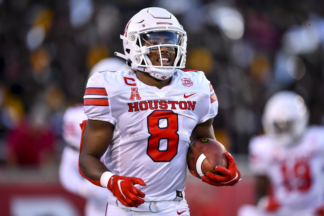Sep 18, 2021; Houston, Texas, USA; Houston Cougars cornerback Marcus Jones (8) celebrates his touchdown during the second quarter against the Grambling State Tigers at TDECU Stadium. Mandatory Credit: Maria Lysaker-USA TODAY Sports