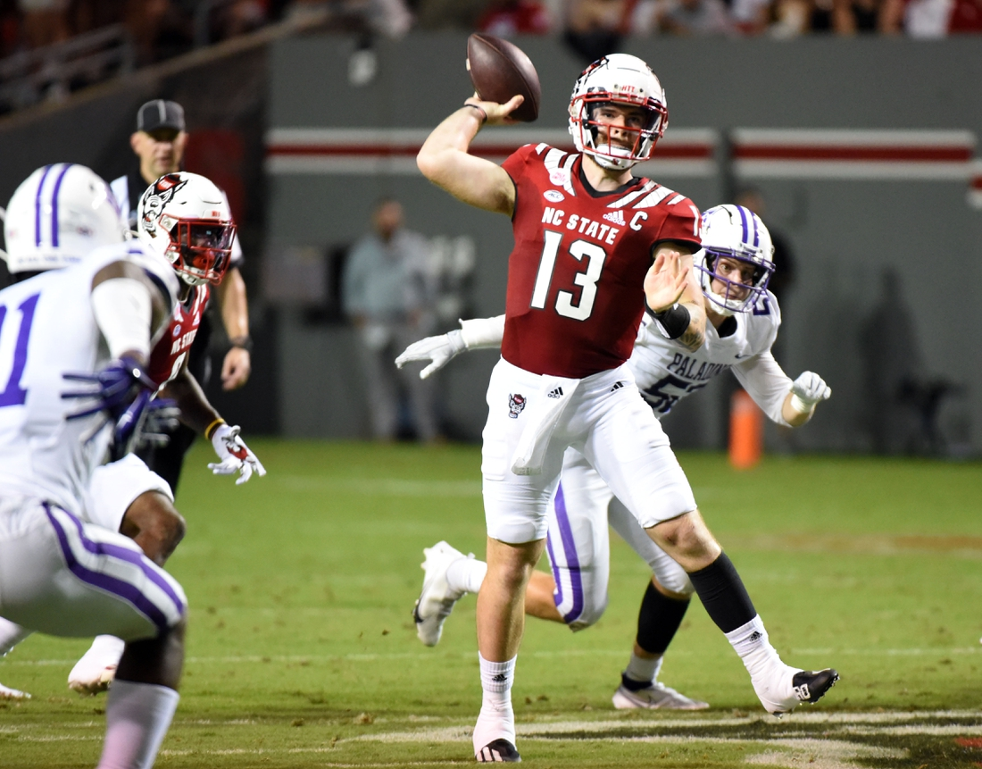 Sep 18, 2021; Raleigh, North Carolina, USA; North Carolina State Wolfpack quarterback Devin Leary (13) throws a pass during the first half against the Furman Paladins at Carter-Finley Stadium. Mandatory Credit: Rob Kinnan-USA TODAY Sports