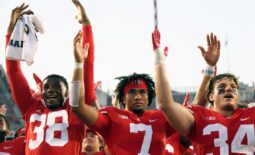Ohio State Buckeyes defensive back Cameron Kittle (38), Ohio State Buckeyes quarterback C.J. Stroud (7) and Ohio State Buckeyes tight end Mitch Rossi (34) sing