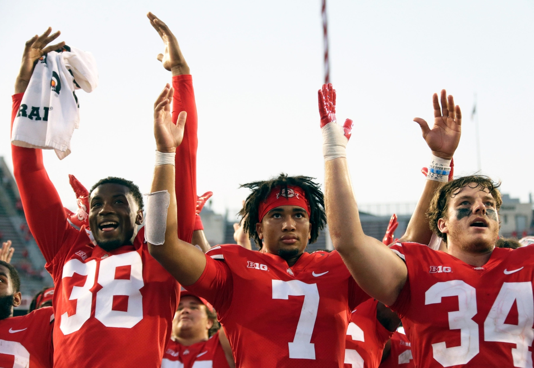 """Ohio State Buckeyes defensive back Cameron Kittle (38), Ohio State Buckeyes quarterback C.J. Stroud (7) and Ohio State Buckeyes tight end Mitch Rossi (34) sing """"Carmen Ohio"""" following Saturday's NCAA Division I football game against the Tulsa Golden Hurricanes at Ohio Stadium in Columbus on September 18, 2021. Ohio State won the game 41-20.  Osu21tlsa Bjp 1218"""
