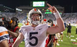 Sep 18, 2021; Chapel Hill, North Carolina, USA; Virginia Cavaliers quarterback Brennan Armstrong (5) reacts after throwing a touchdown pass near the end of the second quarter at Kenan Memorial Stadium. Mandatory Credit: Bob Donnan-USA TODAY Sports
