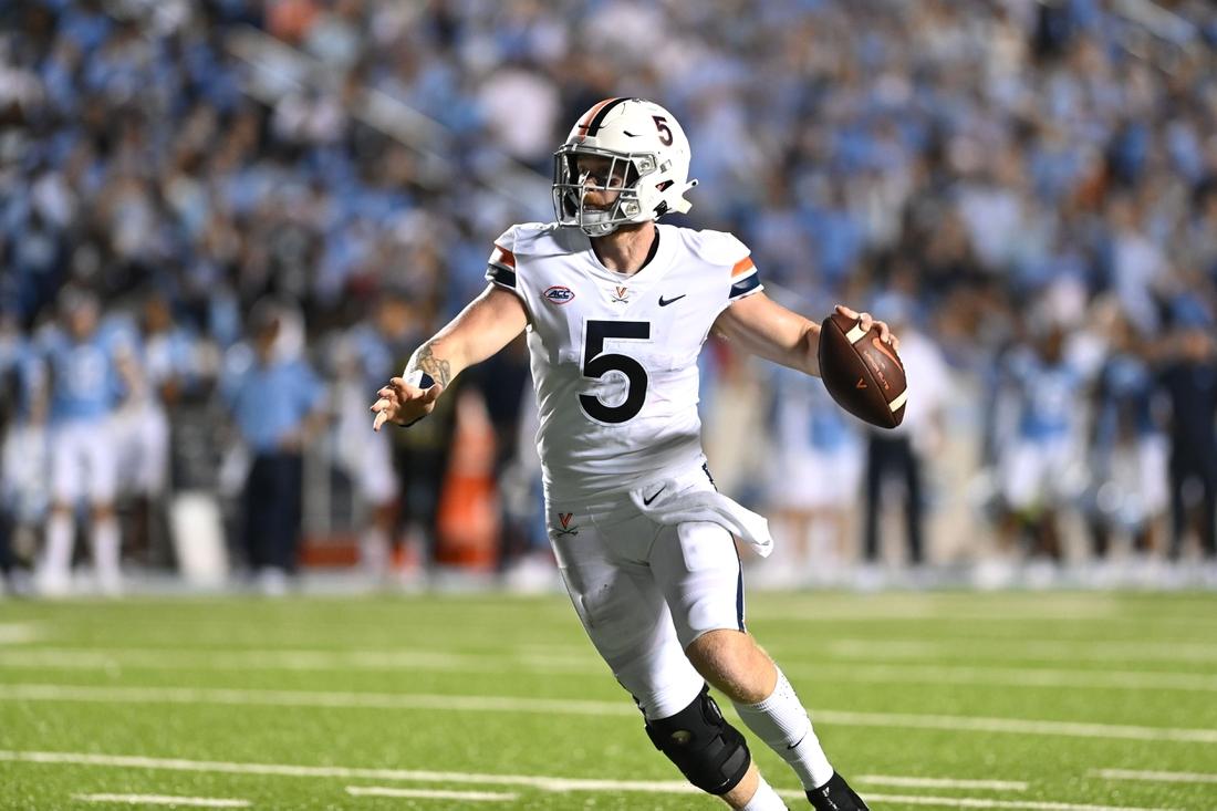 Sep 18, 2021; Chapel Hill, North Carolina, USA; Virginia Cavaliers quarterback Brennan Armstrong (5) looks to pass in the second quarter at Kenan Memorial Stadium. Mandatory Credit: Bob Donnan-USA TODAY Sports