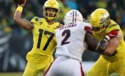 Oregon's Ty Thompson, left, throws down field against Stony Brook during the third quarter.  Eug 091821 Oregonfb 14