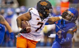 Sep 18, 2021; Boise, Idaho, USA;  Boise State Broncos safety Rodney Robinson (4) gets a stiff arm from Oklahoma State Cowboys running back Jaylen Warren (7) during the first half of play  at Albertsons Stadium. Mandatory Credit: Brian Losness-USA TODAY Sports