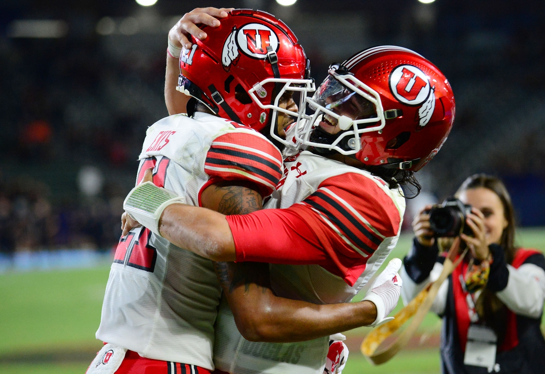 Sep 18, 2021; Carson, California, USA; Utah Utes quarterback Cameron Rising (7) celebrates with wide receiver Solomon Enis (21) the successful two point conversion against the San Diego State Aztecs during the second half at Dignity Health Sports Park. Mandatory Credit: Gary A. Vasquez-USA TODAY Sports
