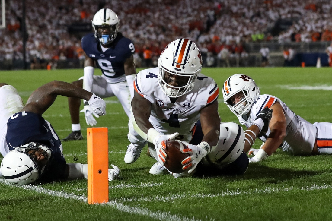 Sep 18, 2021; University Park, Pennsylvania, USA; Auburn Tigers running back Tank Bigsby (4) dives with the ball towards the end zone pylon for a touchdown during the third quarter against the Penn State Nittany Lions at Beaver Stadium. Penn State defeated Auburn 28-20. Mandatory Credit: Matthew OHaren-USA TODAY Sports