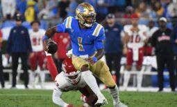 Sep 18, 2021; Pasadena, California, USA; UCLA Bruins quarterback Dorian Thompson-Robinson (1) looks to pass against Fresno State Bulldogs defensive back Justin Houston (13) in the second quarter at Rose Bowl. Mandatory Credit: Richard Mackson-USA TODAY Sports