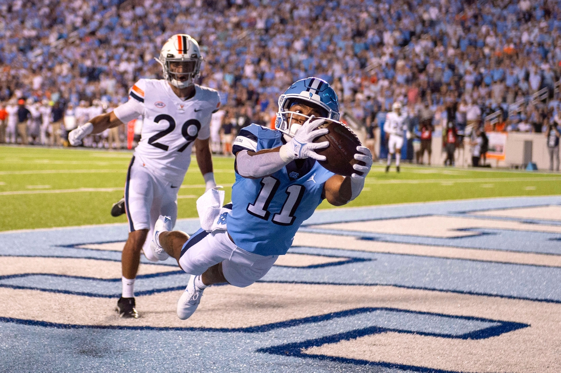 Sep 18, 2021; Chapel Hill, North Carolina, USA; North Carolina Tar Heels wide receiver Josh Downs (11) catches a touchdown in the end zone as Virginia Cavaliers free safety Joey Blount (29) defends in the first quarter at Kenan Memorial Stadium. Mandatory Credit: Bob Donnan-USA TODAY Sports