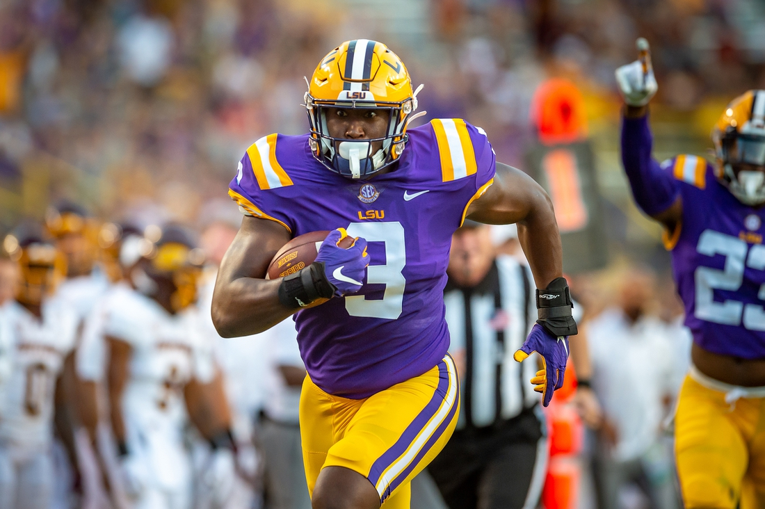 Sep 18, 2021; Baton Rouge, LA, USA; LSU Tigers defensive end Andre Anthony (3) runs back a fumble against the Central Michigan Chippewas for a score at Tiger Stadium. Mandatory Credit: Scott Clause/The Advertiser via USA TODAY NETWORK