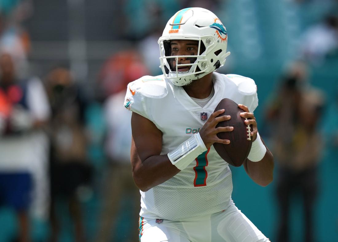 Sep 19, 2021; Miami Gardens, Florida, USA; Miami Dolphins quarterback Tua Tagovailoa (1) attempts a pass against the Buffalo Bills during the first half at Hard Rock Stadium. Mandatory Credit: Jasen Vinlove-USA TODAY Sports