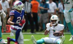 Sep 19, 2021; Miami Gardens, Florida, USA; Miami Dolphins quarterback Tua Tagovailoa (1) reacts after being sacked by Buffalo Bills cornerback Taron Johnson (24) during the first half at Hard Rock Stadium. Mandatory Credit: Jasen Vinlove-USA TODAY Sports