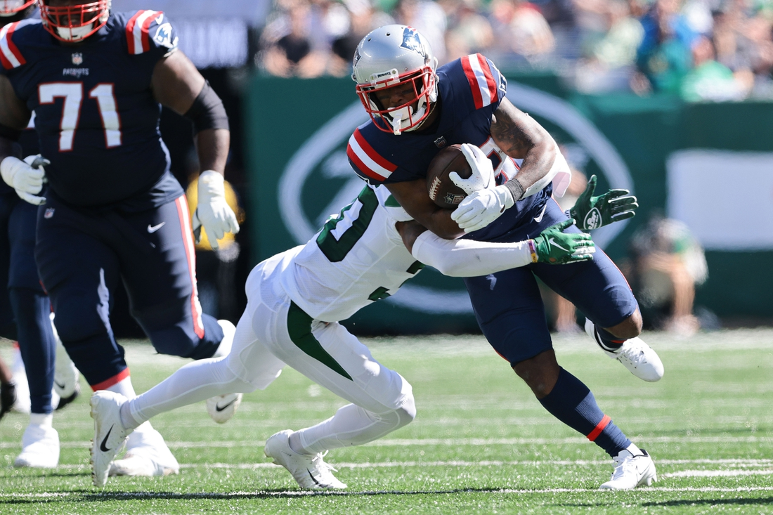 Sep 19, 2021; East Rutherford, New Jersey, USA; New England Patriots running back James White (28) carries the ball as New York Jets cornerback Michael Carter II (30) tackles during the first half at MetLife Stadium. Mandatory Credit: Vincent Carchietta-USA TODAY Sports