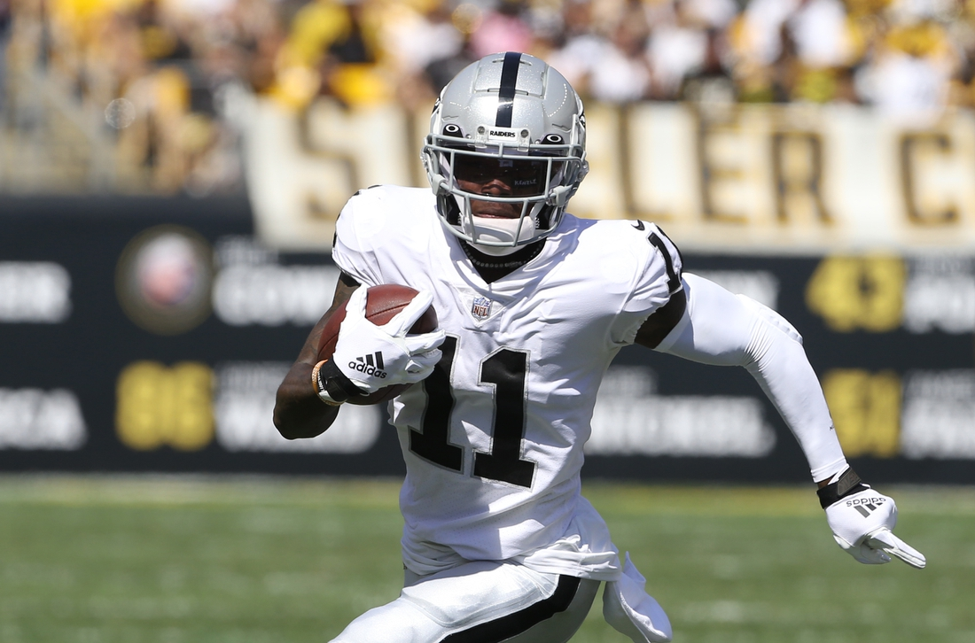 Sep 19, 2021; Pittsburgh, Pennsylvania, USA;  Las Vegas Raiders wide receiver Henry Ruggs III (11) runs after a catch against the Pittsburgh Steelers during the second quarter at Heinz Field. Mandatory Credit: Charles LeClaire-USA TODAY Sports