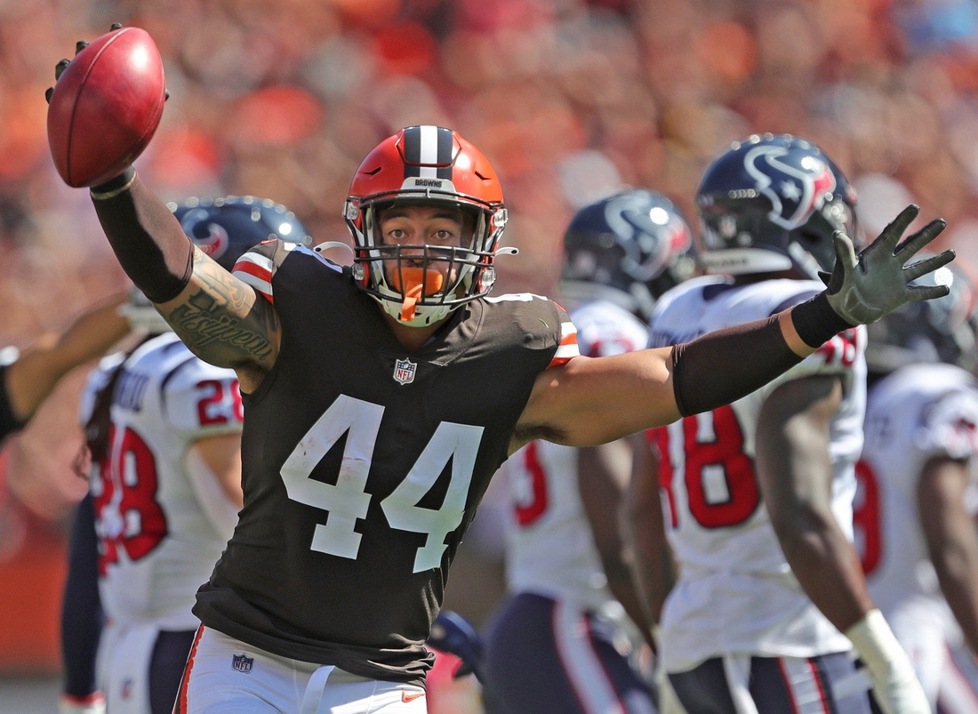 Cleveland Browns linebacker Sione Takitaki (44) celebrates after recovering a fumbled punt during the first half of an NFL football game against the Houston Texans, Sunday, Sept. 19, 2021, in Cleveland, Ohio. [Jeff Lange/Beacon Journal]  Browns 4
