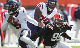 Cleveland Browns defensive end Myles Garrett (95) is held by Houston Texans offensive tackle Geron Christian (72) as he rushes Houston Texans quarterback Tyrod Taylor (5) during the first half of an NFL football game, Sunday, Sept. 19, 2021, in Cleveland, Ohio. [Jeff Lange/Beacon Journal]  Browns 6