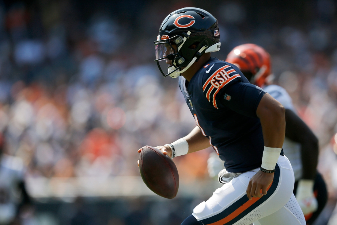 Chicago Bears quarterback Justin Fields (1) runs out of the pocket in the second quarter of the NFL Week 2 game between the Chicago Bears and the Cincinnati Bengals at Soldier Field in Chicago on Sunday, Sept. 19, 2021. The Bears led 7-0 at halftime.  Cincinnati Bengals At Chicago Bears