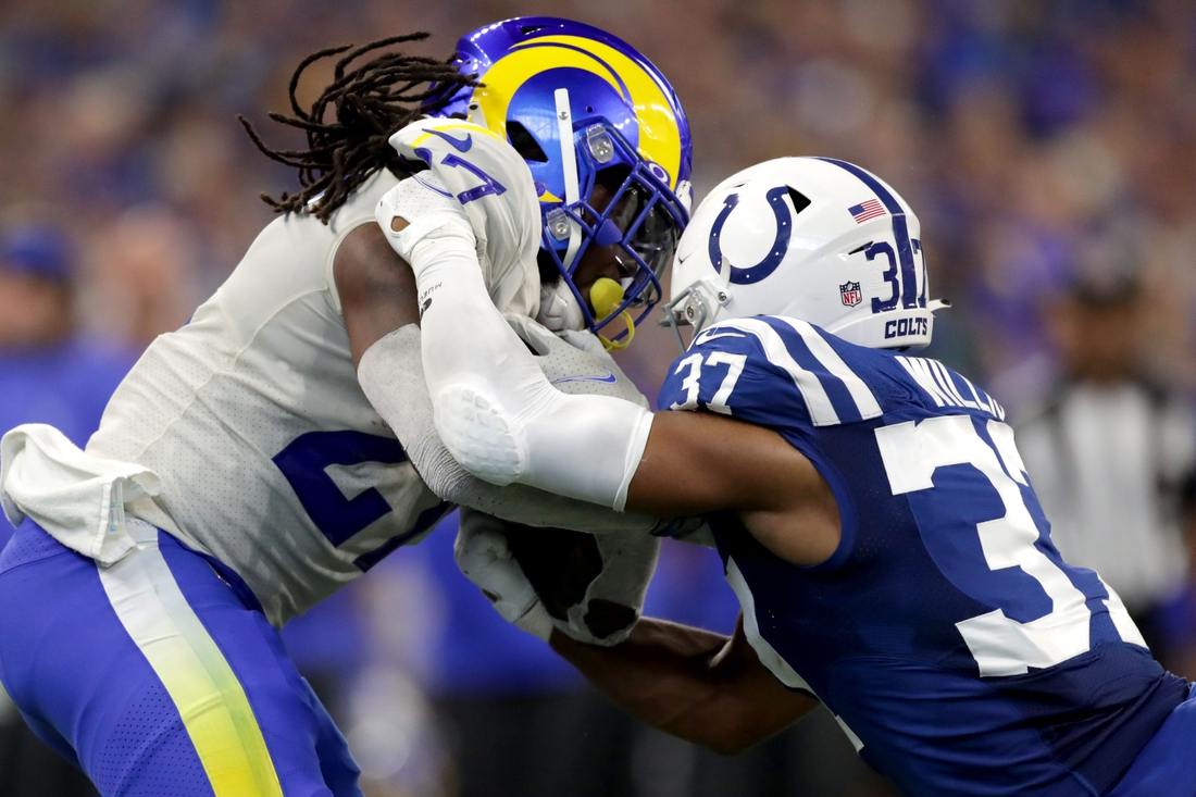 Indianapolis Colts safety Khari Willis (37) works to bring down Los Angeles Rams running back Darrell Henderson Jr. (27) on Sunday, Sept. 19, 2021, during a game against the Los Angeles Rams at Lucas Oil Stadium in Indianapolis.