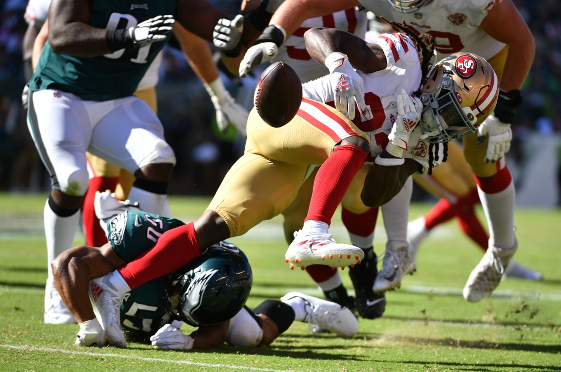 Sep 19, 2021; Philadelphia, Pennsylvania, USA;  San Francisco 49ers running back JaMycal Hasty (23) fumbles the football after being hit by Philadelphia Eagles linebacker Eric Wilson (50) during the fourth quarter at Lincoln Financial Field. Mandatory Credit: Eric Hartline-USA TODAY Sports