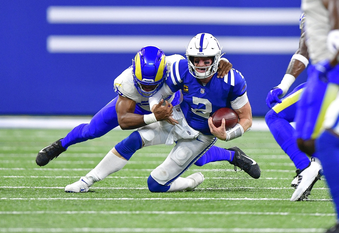 Sep 19, 2021; Indianapolis, Indiana, USA; Indianapolis Colts quarterback Carson Wentz (2) is sacked by Los Angeles Rams linebacker Justin Hollins (58) during the second half at Lucas Oil Stadium. Rams win 24-21. Mandatory Credit: Marc Lebryk-USA TODAY Sports