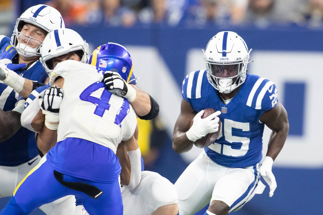 Sep 19, 2021; Indianapolis, Indiana, USA; Indianapolis Colts running back Marlon Mack (25) runs the ball in the second half against the Los Angeles Rams at Lucas Oil Stadium. Mandatory Credit: Trevor Ruszkowski-USA TODAY Sports