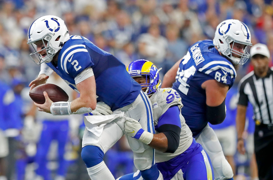 Indianapolis Colts quarterback Carson Wentz (2) keeps hold of the ball during the second half of an Indianapolis Colts game against the Los Angeles Rams on Sunday, Sept. 19, 2021, at Lucas Oil Stadium. The Rams won 27-24.