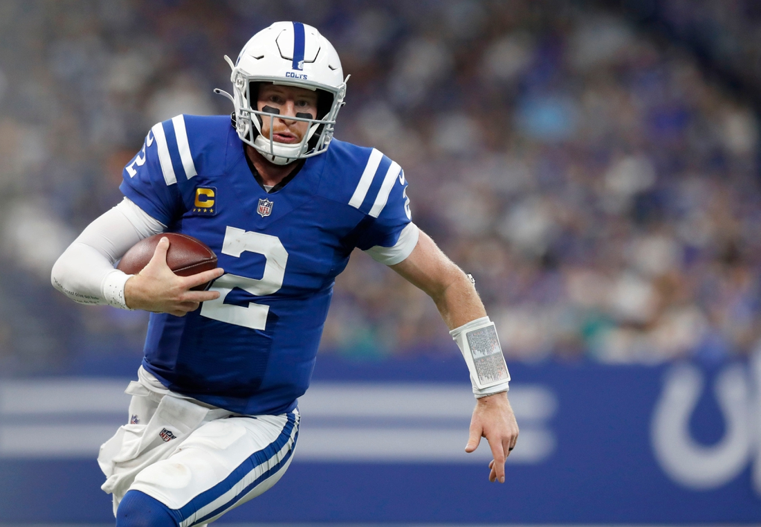 Indianapolis Colts quarterback Carson Wentz (2) runs the ball up the field during the second half of an Indianapolis Colts game against the Los Angeles Rams on Sunday, Sept. 19, 2021, at Lucas Oil Stadium. The Rams won 27-24.