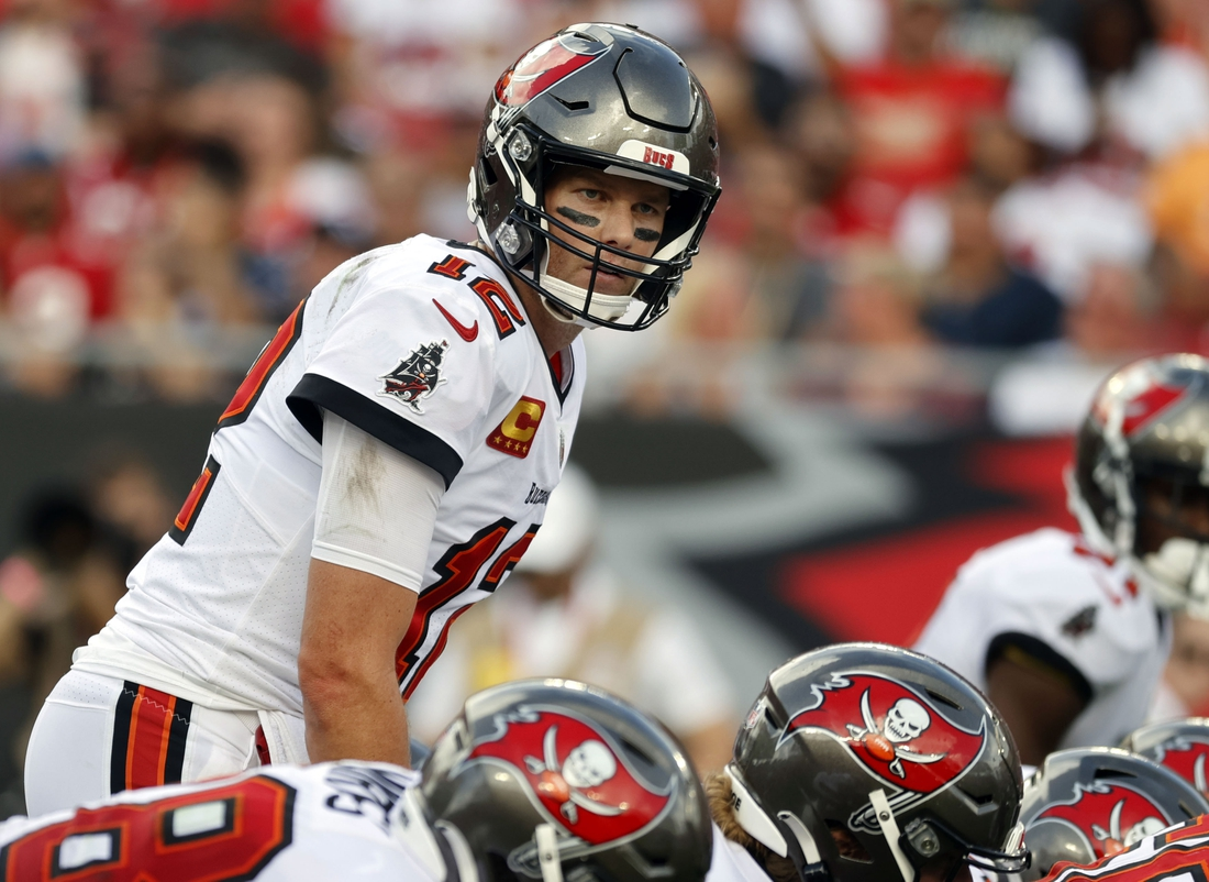 Sep 19, 2021; Tampa, Florida, USA; Tampa Bay Buccaneers quarterback Tom Brady (12) looks on against the Atlanta Falcons during the first half at Raymond James Stadium. Mandatory Credit: Kim Klement-USA TODAY Sports