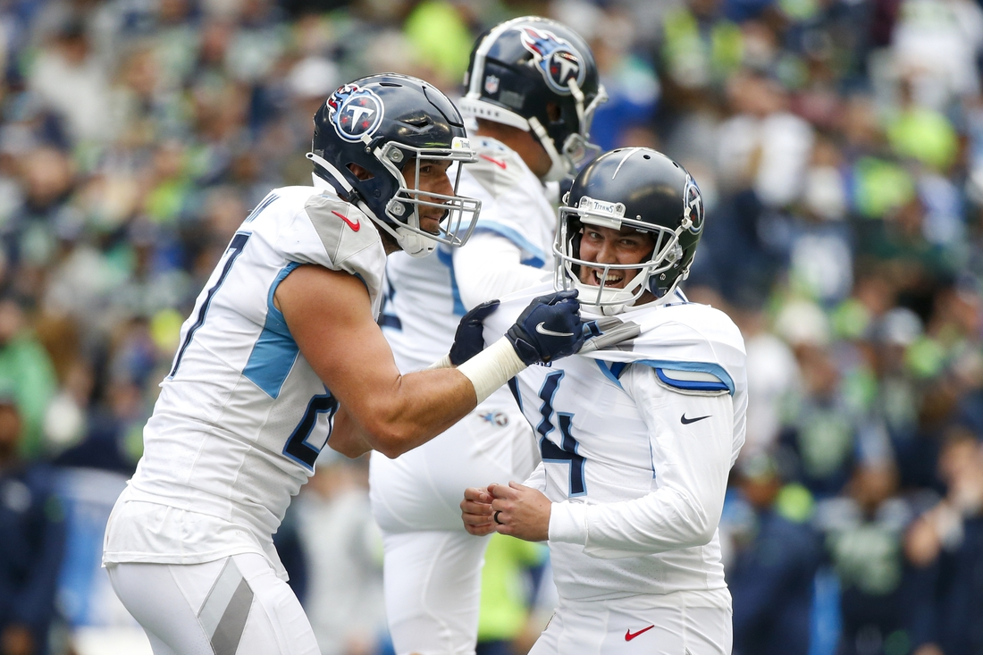 Sep 19, 2021; Seattle, Washington, USA; Tennessee Titans kicker Randy Bullock (14) celebrates with tight end Geoff Swaim (87) after kicking a game-winning field goal in overtime against the Seattle Seahawks at Lumen Field. Mandatory Credit: Joe Nicholson-USA TODAY Sports