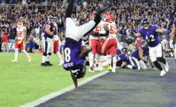 Sep 19, 2021; Baltimore, Maryland, USA;  Baltimore Ravens quarterback Lamar Jackson (8) flips into the end zone for  a fourth quarter touchdown  against the Kansas City Chiefs at M&T Bank Stadium. Mandatory Credit: Tommy Gilligan-USA TODAY Sports