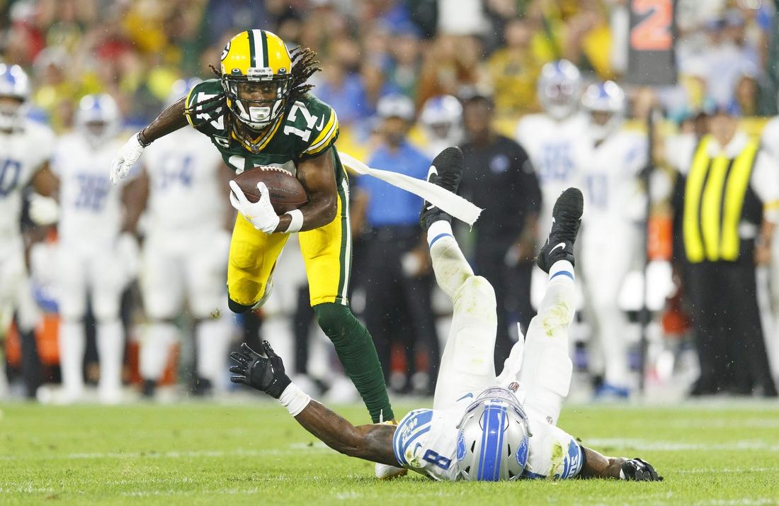 Green Bay Packers wide receiver Davante Adams (17) runs the football over Detroit Lions linebacker Jamie Collins Sr. (8) during the third quarter at Lambeau Field. Mandatory Credit: Jeff Hanisch-USA TODAY Sports