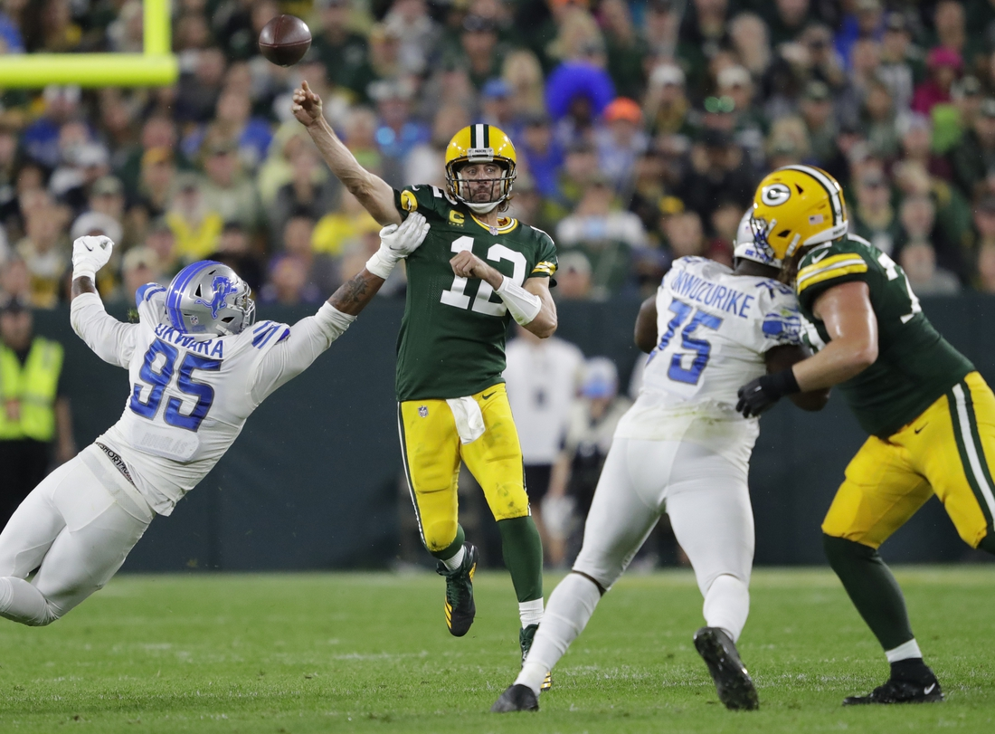 Sep 20, 2021; Green Bay, WIsconsin, USA; Green Bay Packers quarterback Aaron Rodgers (12) passes the ball against the Detroit Lions at Lambeau Field. Mandatory Credit: Dan Powers/Appleton Post-Crescent via USA TODAY NETWORK